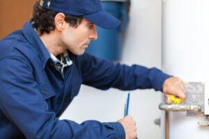 Plumber-repairing-water heater